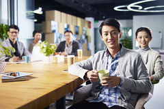 Young asian entrepreneurs meeting in office Stock Photos