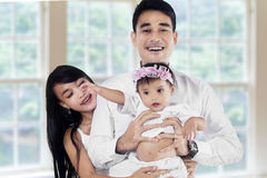 Young asian family in new home Stock Images