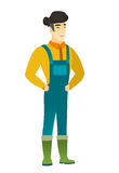 Young asian farmer in coveralls laughing. Royalty Free Stock Images