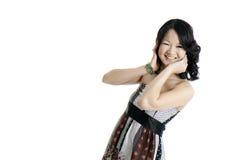 A young asian fashion model. A beautiful young asian fashion model, wearing a dress and isolated on white Stock Photo