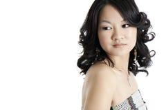 A young asian fashion model. A beautiful young asian fashion model, wearing a dress and isolated on white Stock Photos