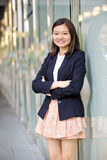 Young Asian female business executive smiling Royalty Free Stock Photography