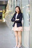 Young Asian female business executive smiling Stock Image