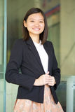 Young Asian female business executive smiling Royalty Free Stock Image