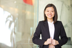 Young Asian female business executive smiling Royalty Free Stock Photo