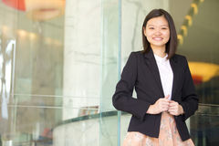 Young Asian female business executive smiling Stock Photo