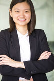 Young Asian female business executive smiling Stock Photos