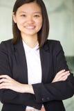 Young Asian female business executive smiling Stock Photos