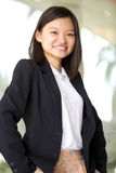 Young Asian female business executive smiling Royalty Free Stock Photos