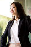 Young Asian female business executive smiling Royalty Free Stock Images