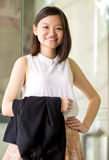Young Asian female business executive smiling Stock Images