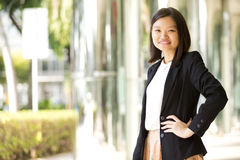 Young Asian female business executive smiling Stock Photography