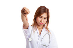 Young Asian female doctor angry show thumbs down Stock Photos