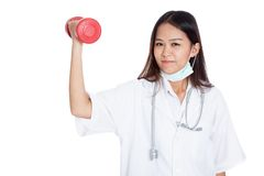Young Asian female doctor with dumbbell Stock Photography