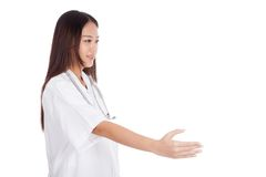 Young Asian female doctor greeting shaking hand Royalty Free Stock Images