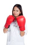 Young Asian female doctor guard with boxing glove Royalty Free Stock Photo