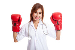Young Asian female doctor guard with boxing glove Royalty Free Stock Image
