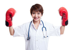 Young Asian female doctor guard with boxing glove. Stock Photo