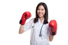 Young Asian female doctor guard with boxing glove. Stock Images