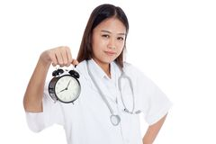 Young Asian female doctor happy show a clock Royalty Free Stock Image