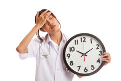 Young Asian female doctor headache with a clock Stock Image