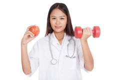 Young Asian female doctor  hold apple and dumbbell Royalty Free Stock Image
