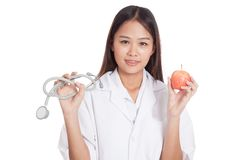 Young Asian female doctor hold  apple and stethoscope Stock Images