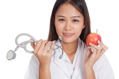 Young Asian female doctor hold  apple and stethoscope Royalty Free Stock Image
