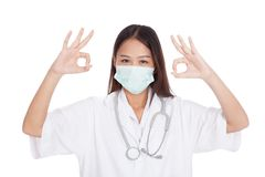 Young Asian female doctor with mask show OK with both hands Stock Images