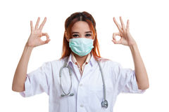 Young Asian female doctor with mask show OK with both hands. Stock Image