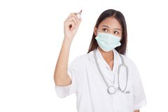 Young Asian female doctor with mask write with red marker Stock Images