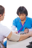 Young asian female doctor measuring blood pressure Stock Photos