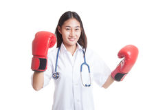 Young Asian female doctor ready to fight. Young Asian female doctor ready to fight isolated on white background royalty free stock image