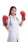 Young Asian female doctor ready to fight. Young Asian female doctor ready to fight isolated on white background stock photography