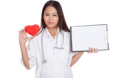 Young Asian female doctor with red heart and blank clipboard Royalty Free Stock Image
