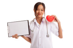 Young Asian female doctor with red heart and blank clipboard. Isolated on white background royalty free stock image