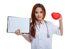 Young Asian female doctor with red heart and blank clipboard. Young Asian female doctor with red heart and blank clipboard isolated on white background stock photo