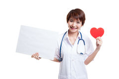 Young Asian female doctor with red heart and blank sign. Young Asian female doctor with red heart and blank sign isolated on white background stock images