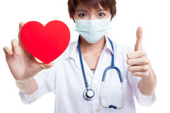 Young Asian female doctor with red heart. Young Asian female doctor with red heart isolated on white background stock photo