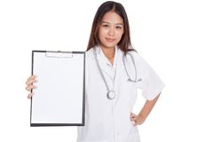 Young Asian female doctor show a blank clipboard Royalty Free Stock Image