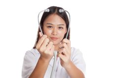 Young Asian female doctor show stethoscope focus at stethoscope Royalty Free Stock Photos
