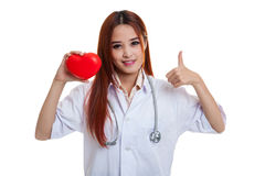 Young Asian female doctor show thumbs up with red heart. Young Asian female doctor show thumbs up with red heart isolated on white background stock photo