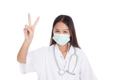 Young Asian female doctor show victory sign Stock Photo