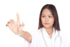 Young Asian female doctor touch a screen Royalty Free Stock Photography