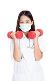 Young Asian female doctor wear mask with dumbbell in both hands Stock Image