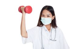 Young Asian female doctor wear mask with dumbbell Royalty Free Stock Image