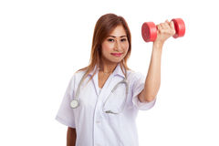 Young Asian female doctor wear mask with dumbbell Royalty Free Stock Photo