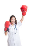 Young Asian female doctor win the fight. Young Asian female doctor win the fight isolated on white background stock images