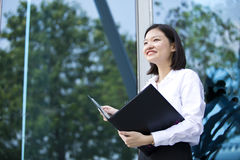 Young Asian female executive holding file Royalty Free Stock Images