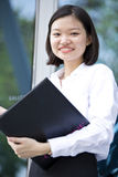Young Asian female executive holding file Royalty Free Stock Photography